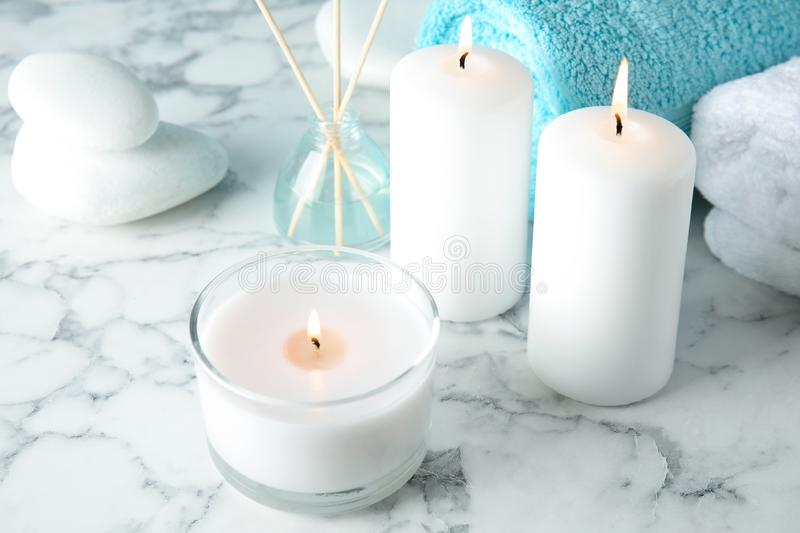Beautiful spa composition with candles and stones. On marble background stock photography