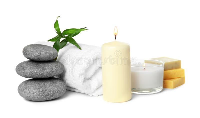 Beautiful spa composition with candles and stones. On white background royalty free stock photography