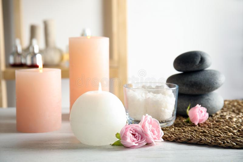 Beautiful spa composition with candles and stones. On wooden table royalty free stock photos