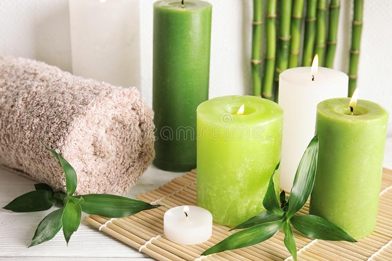 Beautiful spa composition with green candles. On table stock photos