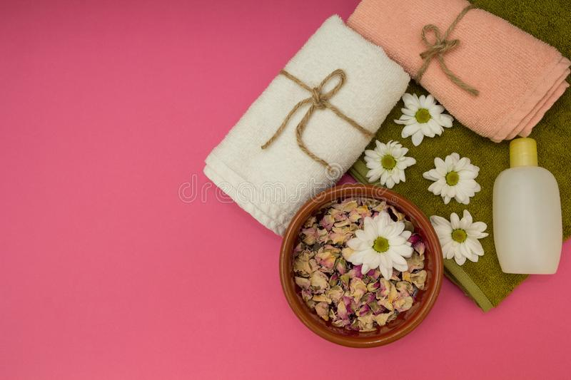 Beautiful spa composition with spring flowers on pink background royalty free stock images
