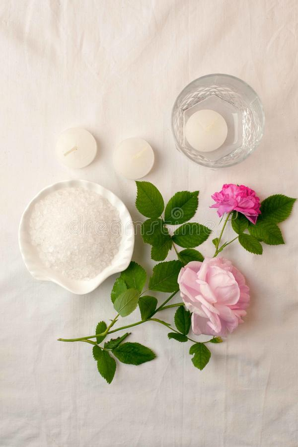 Beautiful spa composition on white tissue background. Concept of relax, wellness and mindfulness royalty free stock photography