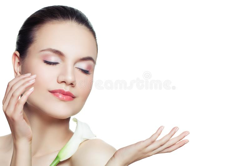 Beautiful spa woman with clear skin isolated on white background. Skincare and facial treatment concept.  royalty free stock image