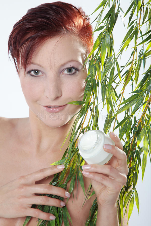 Beautiful spa woman with cream in hand. Beautiful spa woman wit red hair and cream in hand stock images