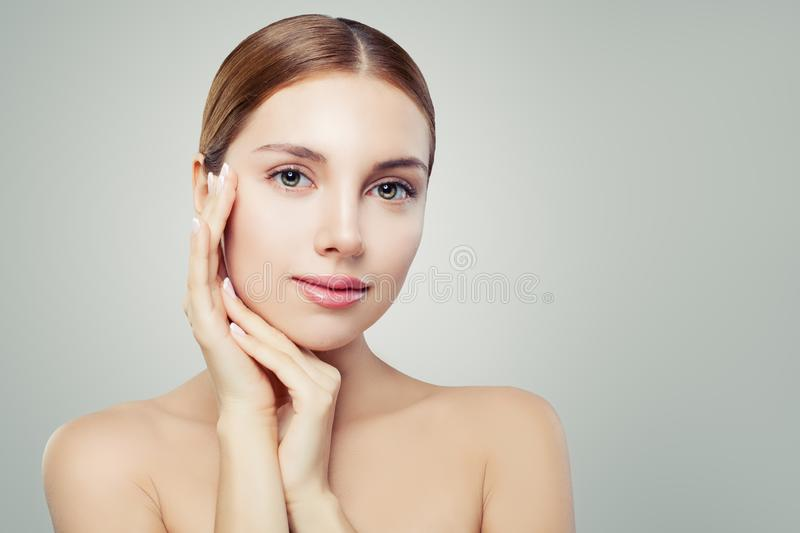 Beautiful spa woman face. Pretty girl with healthy clear skin. Facial treatment, skincare and cosmetology concept.  stock images