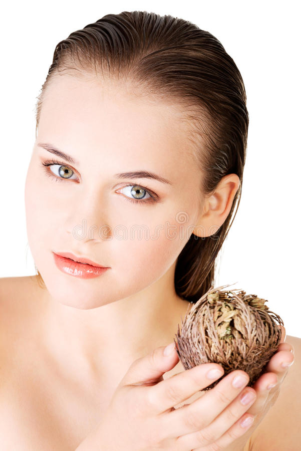 Beautiful spa woman holding Rose of Jericho. Over white royalty free stock image