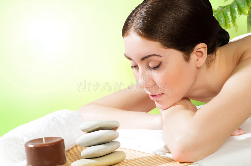 Beautiful spa woman lying on the couch. Gets pleasure royalty free stock photography