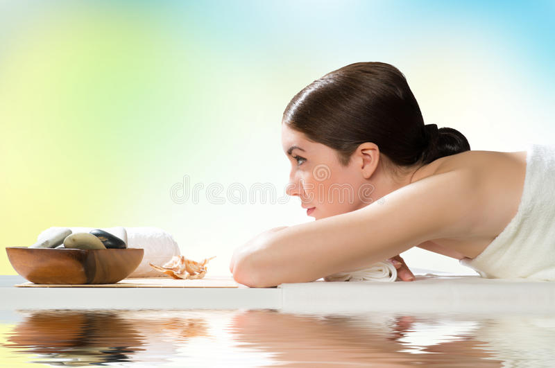 Beautiful spa woman lying on the couch. Gets pleasure royalty free stock photos