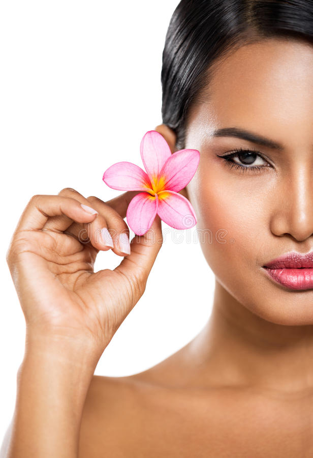 Beautiful spa woman with pink flower. Beautiful spa woman with tropical pink flower, skincare, health and beauty royalty free stock photography
