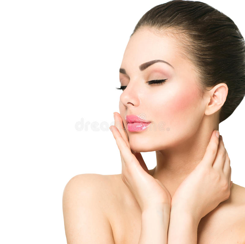 Beautiful spa woman touching her face. Beauty portrait. Beautiful spa woman touching her face royalty free stock photos