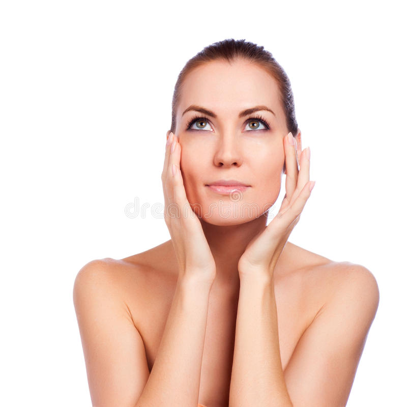 Beautiful Spa Woman Touching her Face. Isolated stock photo