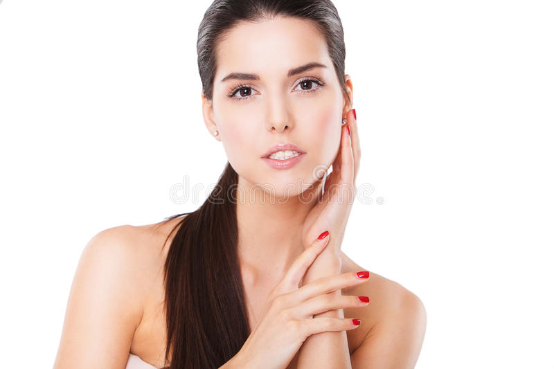 Beautiful Spa Woman Touching her Face. Perfect. Fresh Skin. Pure Beauty Model. Youth and Skin Care Concept royalty free stock images