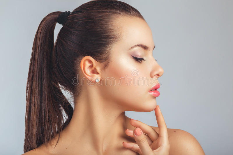 Beautiful Spa Woman Touching her Face. Youth and Skin Care royalty free stock image