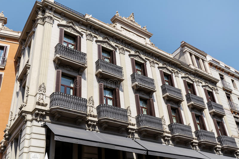Beautiful spanish vintage building in Barcelona ,Spanish. Typical spanish antique building with beautiful windows and balcony -Barcelona,Spain royalty free stock photo
