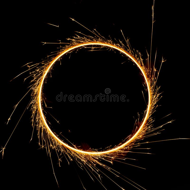 beautiful sparkler in a circle on a black background stock photo