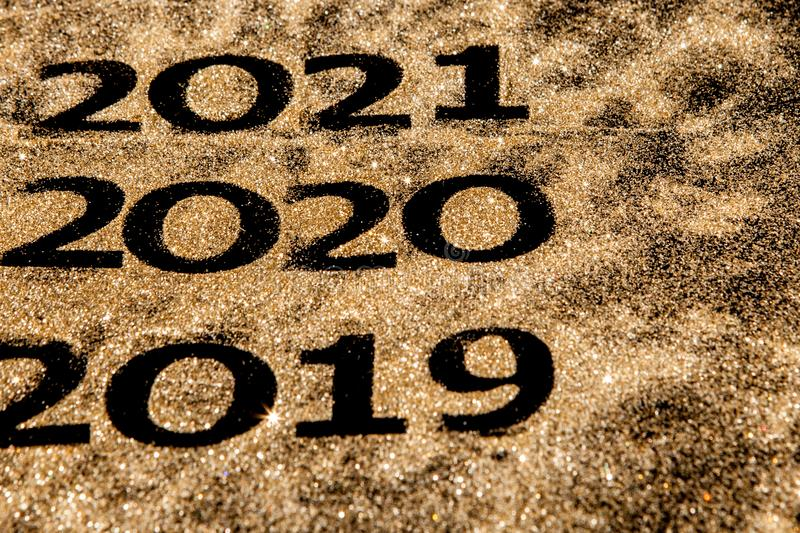 Beautiful sparkling Golden Numbers of 2019 to 2020 on black background for design, happy new year concept stock images