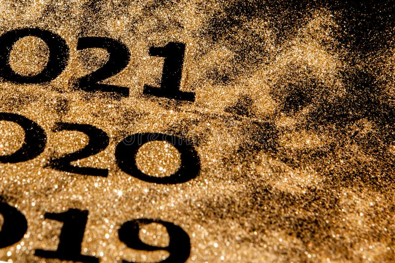 Beautiful sparkling Golden Numbers of 2019 to 2020 on black background for design, happy new year concept stock photos