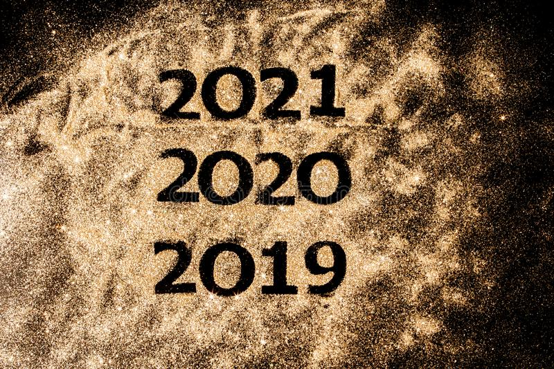 Beautiful sparkling Golden Numbers of 2019 to 2020 on black background for design, happy new year concept stock image