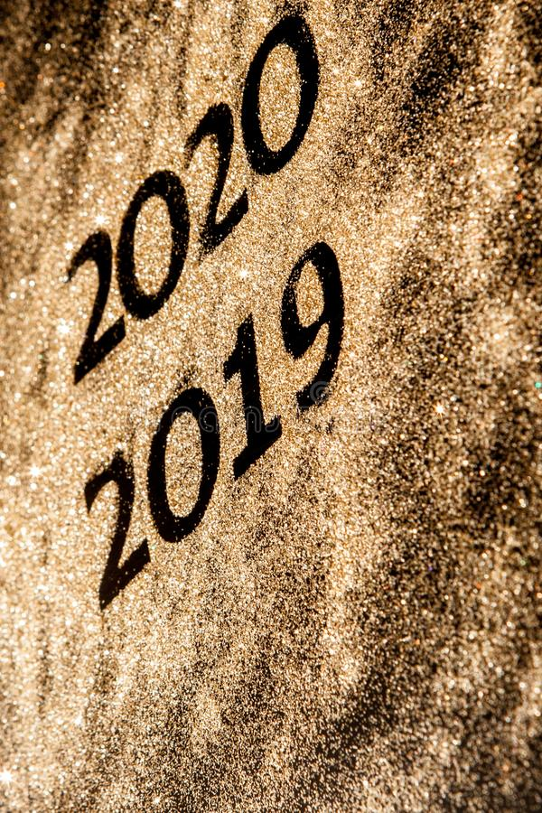 Beautiful sparkling Golden Numbers of 2019 to 2020 on black background for design, happy new year concept stock photo
