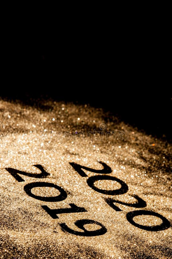 Beautiful sparkling Golden Numbers of 2019 to 2020 on black background for design, happy new year concept royalty free stock photos