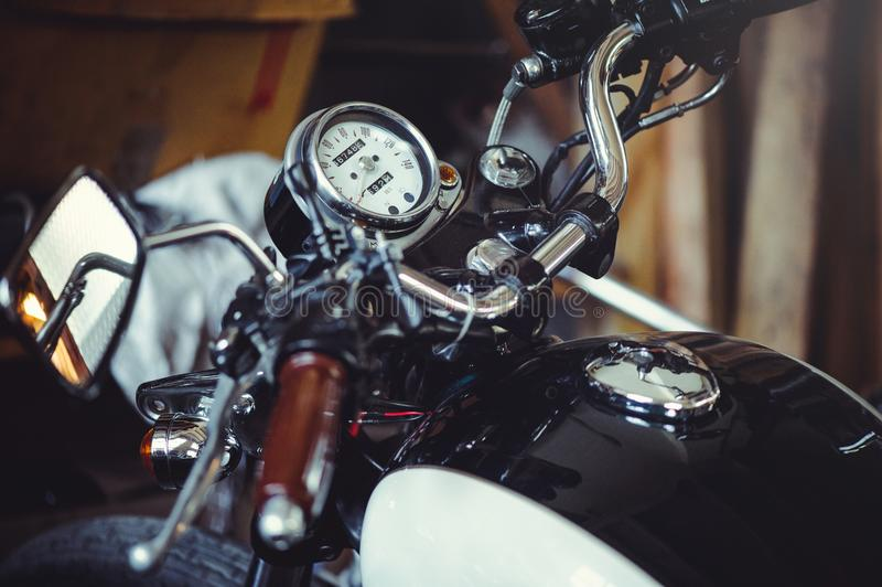 Beautiful speedometer of a classic motorcycle in the frame of the steering wheel mirror and tank royalty free stock photo