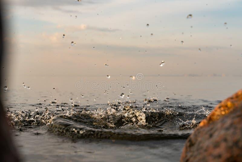 Beautiful splash of water in the sea at sunset. natural desktop background. Splash of water in the sea at sunset. natural desktop background royalty free stock photos