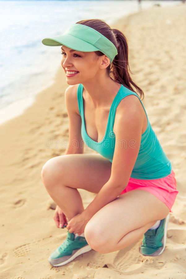 Beautiful sport girl on the beach royalty free stock photos