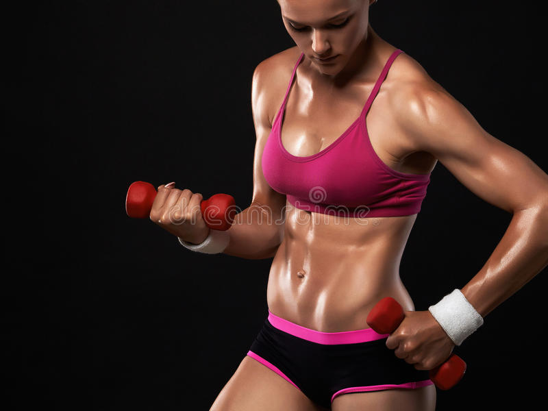 Beautiful sport girl in gym stock photography