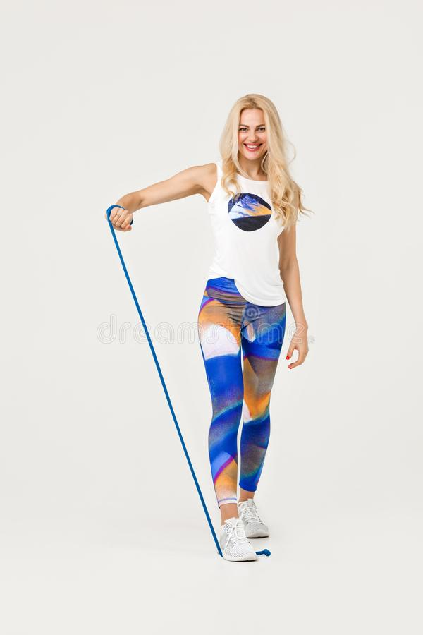 Beautiful sports girl with jumping rope royalty free stock photos