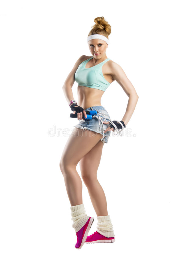 Beautiful sportsgirl with skipping rope royalty free stock image