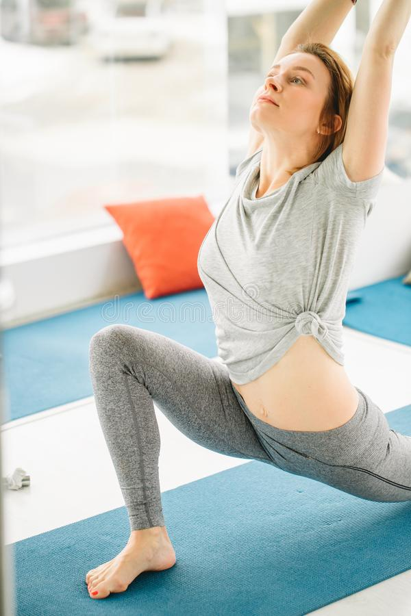 Beautiful sporty fit yogini woman practices yoga asana Virabhadrasana 2 - warrior pose 2 royalty free stock image