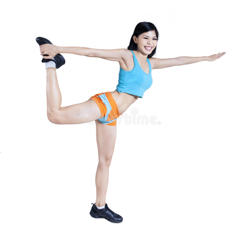 Beautiful sporty girl doing fitness exercise - isolated stock photo