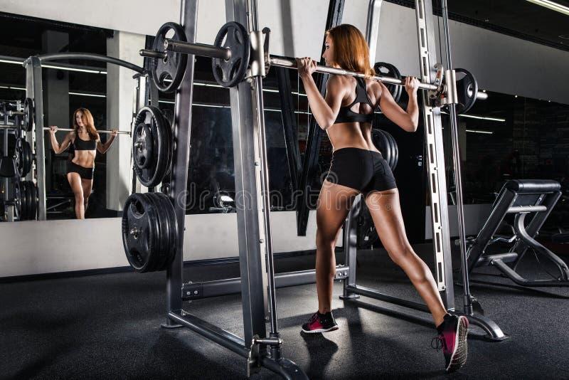 Beautiful sporty woman doing squat stock photos