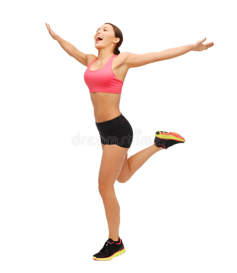 Beautiful sporty woman running or jumping royalty free stock image