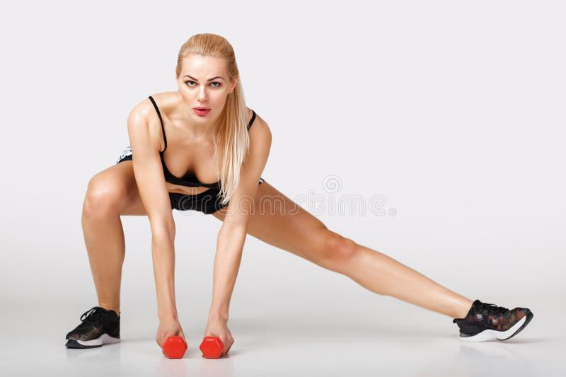 Woman in sportswear does exercises stock photography