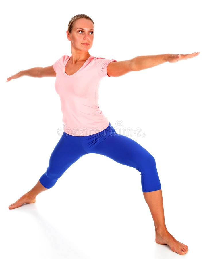 Beautiful sporty young woman practicing yoga warrior pose, isolated on white background stock photos