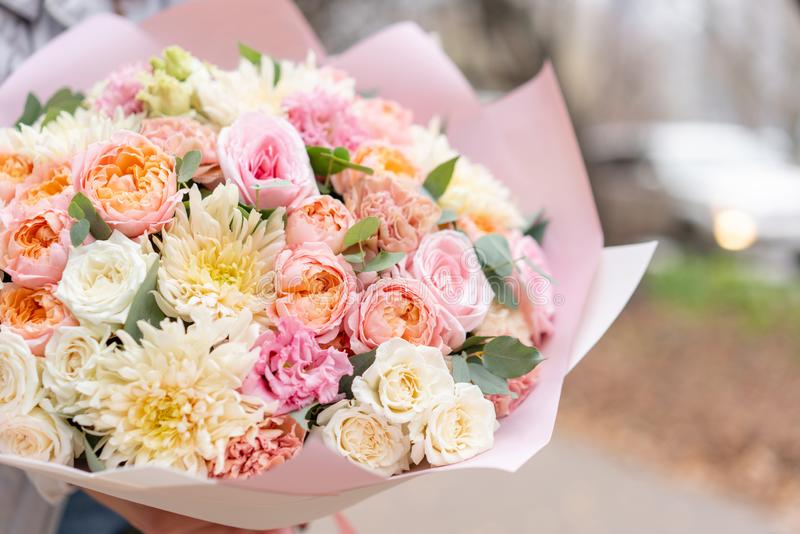 Beautiful spring bouquet in woman hand. Arrangement with various flowers. The concept of a flower shop. A set of photos. For a site or catalogue. Work florist royalty free stock photo