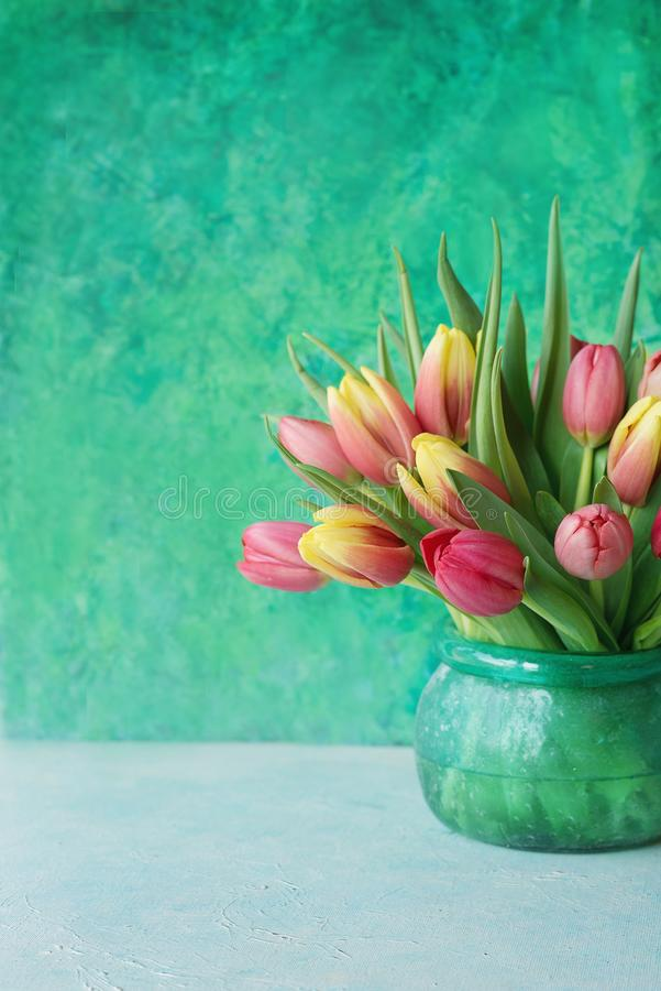 Download Tulips in glass vase stock image. Image of flower, color - 112677527