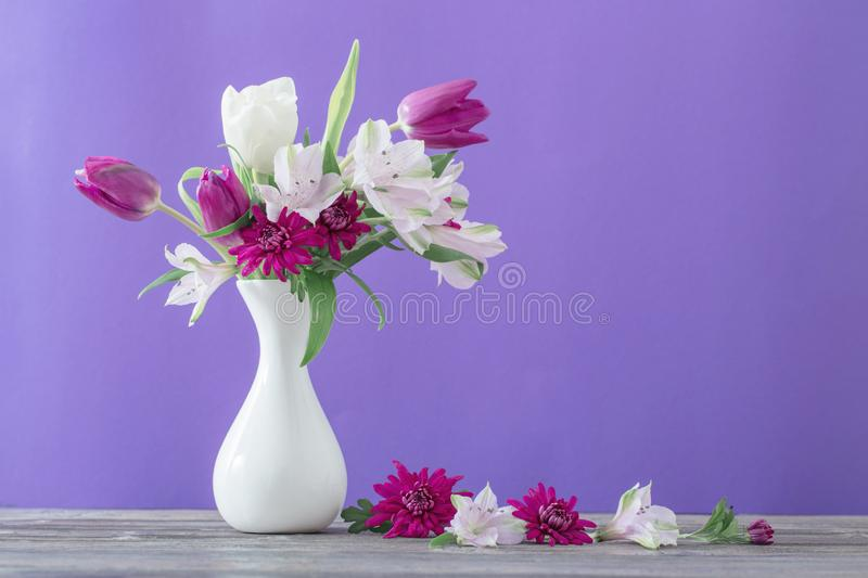 Beautiful spring flowers in white vase stock images
