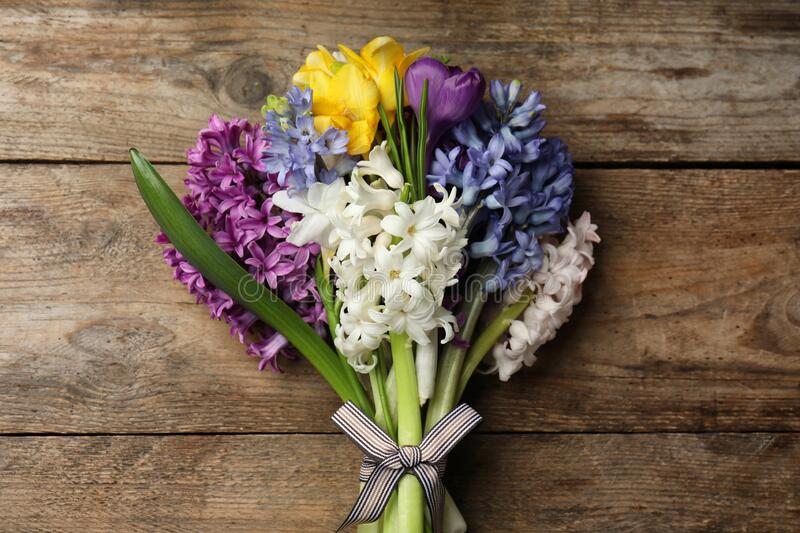 Beautiful spring flowers on wooden table, top view. Beautiful spring flowers on wooden table stock photo