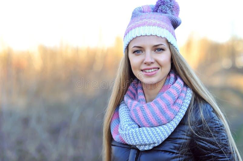 Beautiful spring girl in autumn park.  stock photos