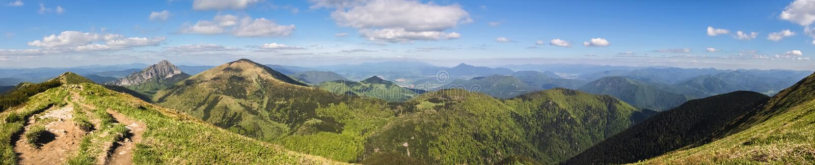 Beautiful spring hilly slovak landscape - Little Fatra hills. Panoramic view from Little Fatra hills National Park - beautiful spring hilly landscape with blue royalty free stock images