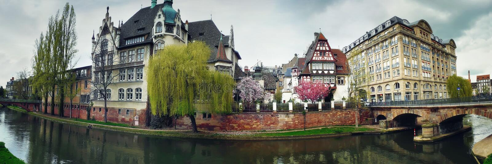 Beautiful spring panorama of Strasbourg city in front of international lyceum Des Pontonniers along canal du Faux-Rempart, Quai royalty free stock photo