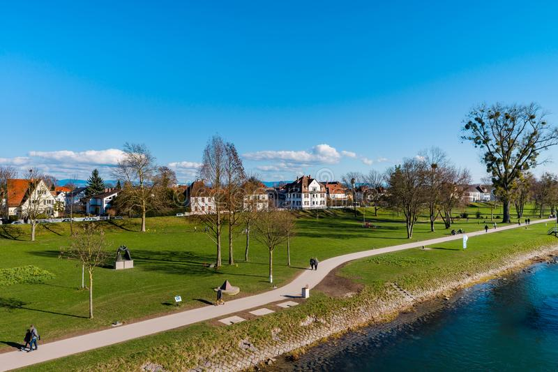 Beautiful spring park on riverside, Rhin, Kehl, Germany. Sunny day stock image