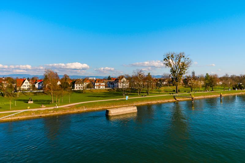 Beautiful spring park on riverside, Rhin, Kehl, Germany. Sunny day stock photo