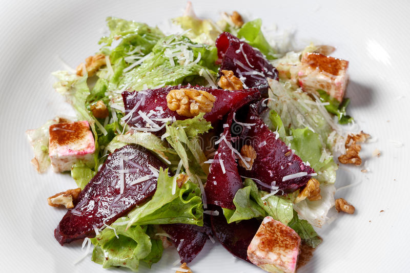 Beautiful Spring Salad with Beet and feta. Beautiful Spring Salad with Beet and Pear, Close-up. kale lettuce, nuts, feta cheese. on a white plate, the dish is stock images