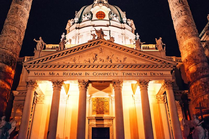 Vienna, Austria. Karlskirche Dome at night. St. Charles church. Beautiful St Charles Church Karlskirche at night with  two colums on the sides. Karlskirche is a stock photography