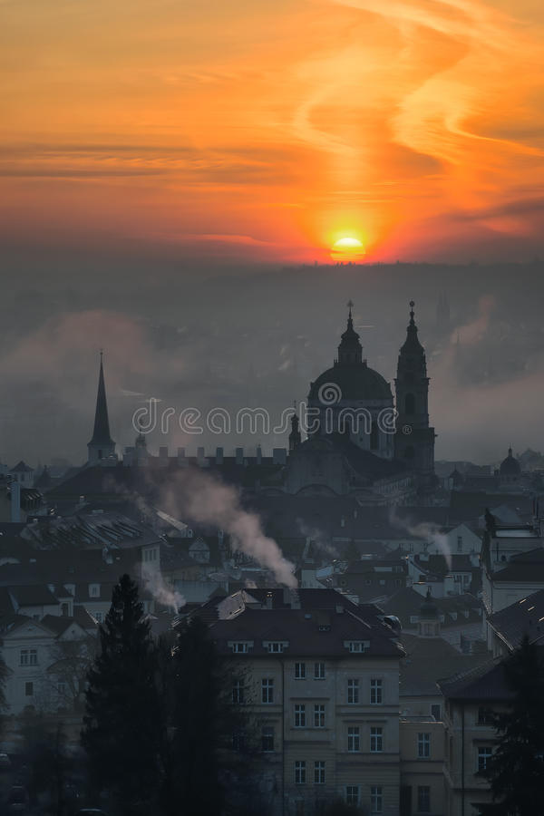 Beautiful St. Nicolas church, Prague, Czech republic. Beautiful St. Nicolas church during foggy sunrise and amazing cloudy sky, Prague, Czech republic stock photo