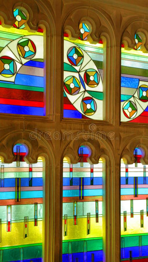The Colors of Chapel Windows. These beautiful stained glass windows grace this small chapel on the grounds of Indiana University stock image