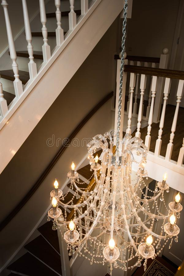 Beautiful staircase in victorian style with crystal chandelier and download beautiful staircase in victorian style with crystal chandelier and decorative railing stock image image mozeypictures Choice Image